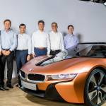 Executives from BMW Group, Intel and Mobileye stand next to a BMW concept car after an announcement that the three companies would be working on an autonomous driving system. From left: Klaus Fröhlich of BMW; Ziv Aviram of Mobileye;  Amnon Shashua of Mobileye; Harald Krüger of BMW; Brian Krzanich of Intel; and Doug Davis of Intel. At a news conference in Munich, Germany, on Friday, July 1, 2016, the three companies announced a partnership to work together with the goal of bringing highly and fully automated driving into production by 2021. (Credit: BMW Group)